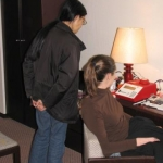 Naoko Funahashi and Debbie Steel using the mobile genetic lab in a hotel room, Tokyo Japan
