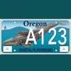 oregon auto license plate with cow and calf humpback whales in a wave